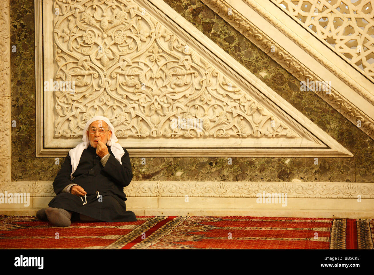 Old man inside the Great Umayyad Mosque, Damascus Stock Photo