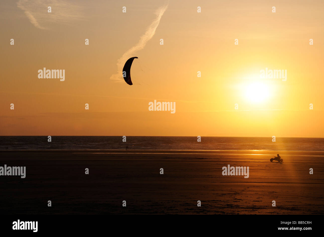 Lone kitebuggy at sunset Stock Photo