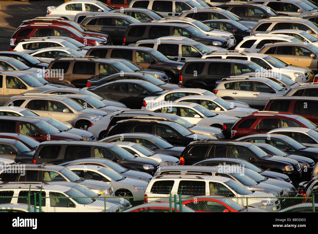 New cars waiting at harbour for shipment to dealers Honolulu Oahu Hawaii USA - Stock Image