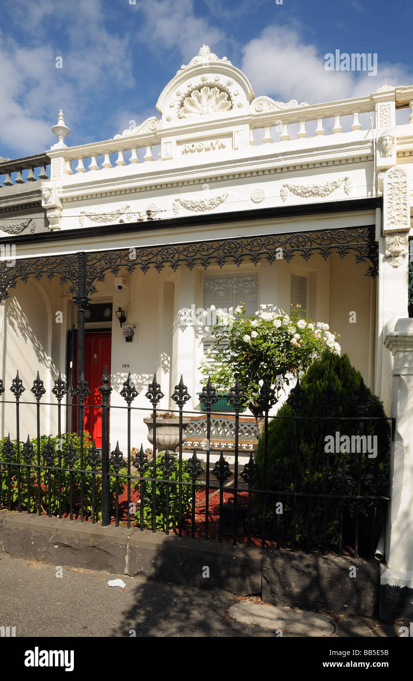 Front of charming old Victorian bungalow Roslyn with ornate cast iron decorations and fence Carlton suburb Melbourne - Stock Image