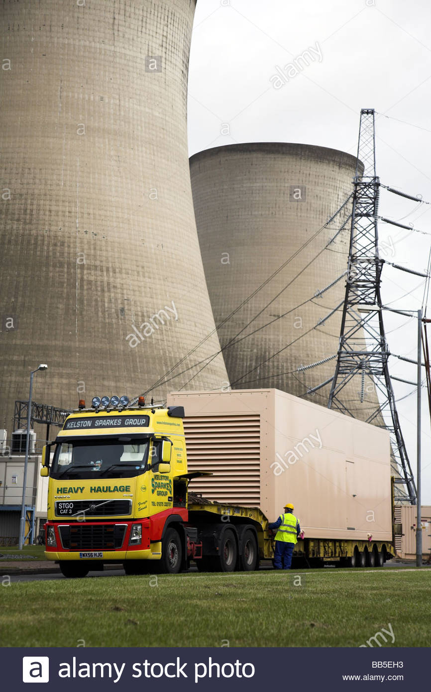 Volvo FH16 lorry with an abnormal load (diesel electrical generator) at Didcot Power Station, Oxfordshire, England, - Stock Image
