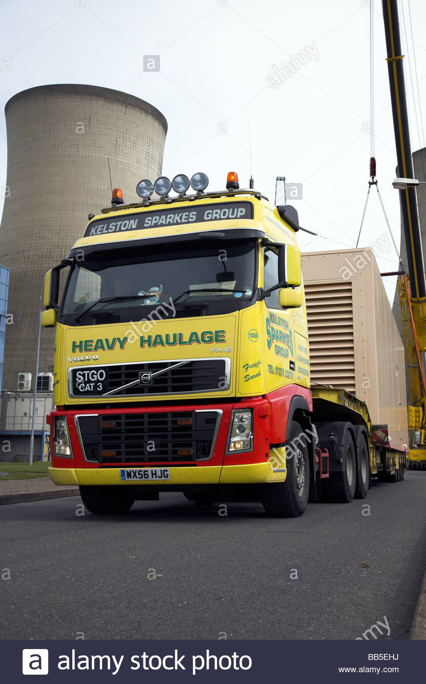 Volvo FH16 lorry with an abnormal load (diesel electrical generator) at Didcot B Power Station, Oxfordshire, England, - Stock Image