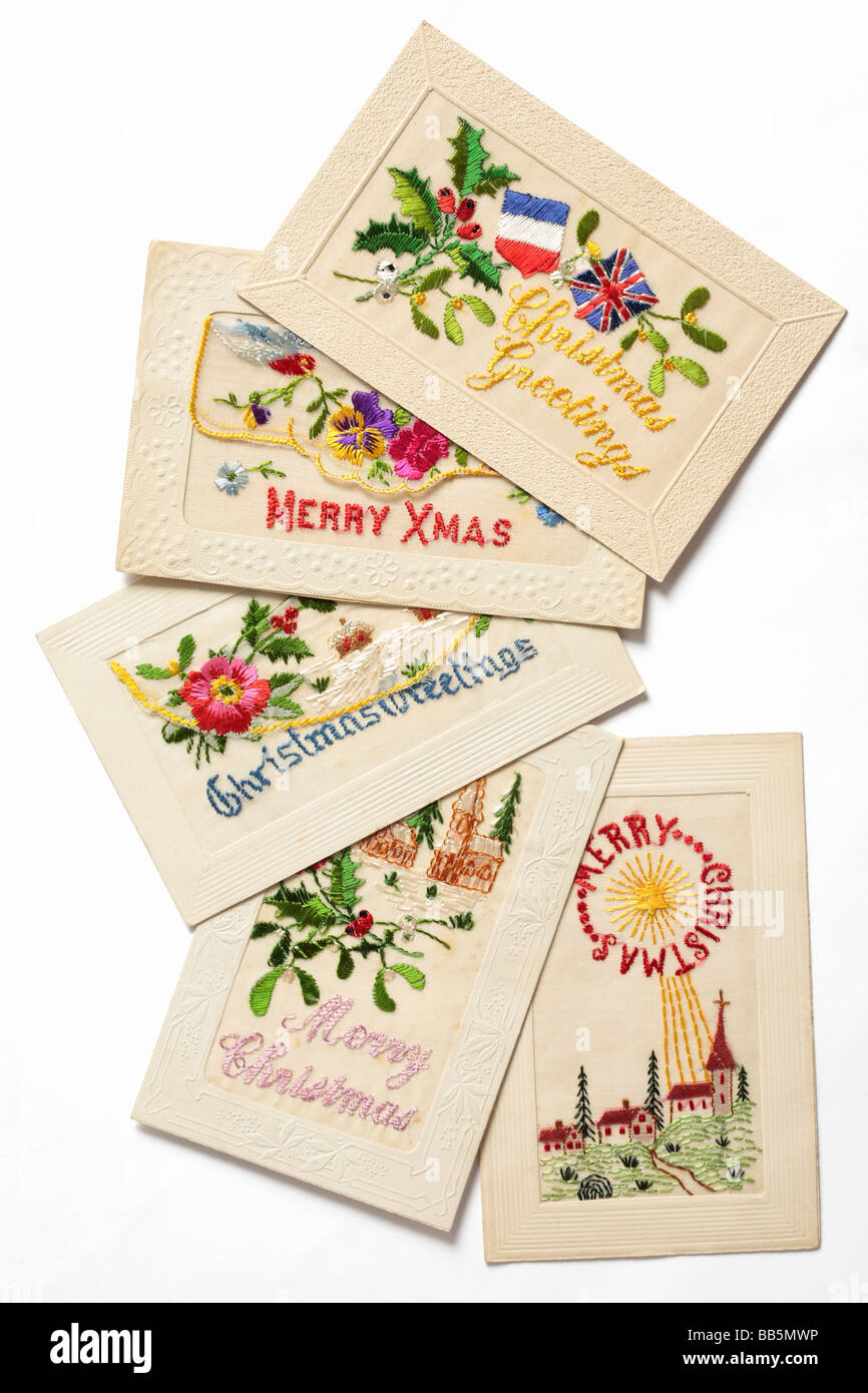 Old silk embroidered postcards. - Stock Image