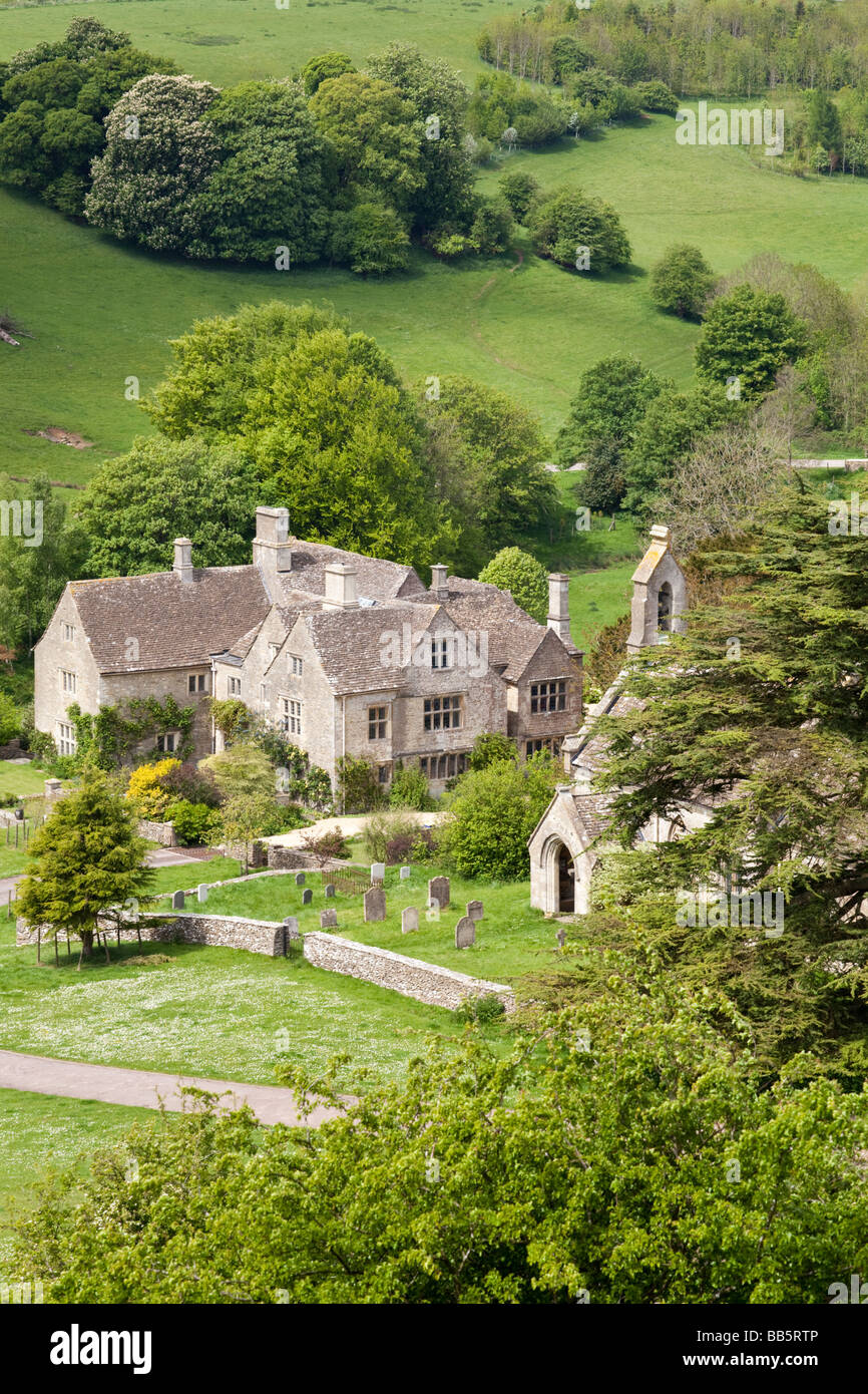 Lasborough Manor and St Marys church in the Cotswold hamlet of Lasborough, Gloucestershire. Stock Photo