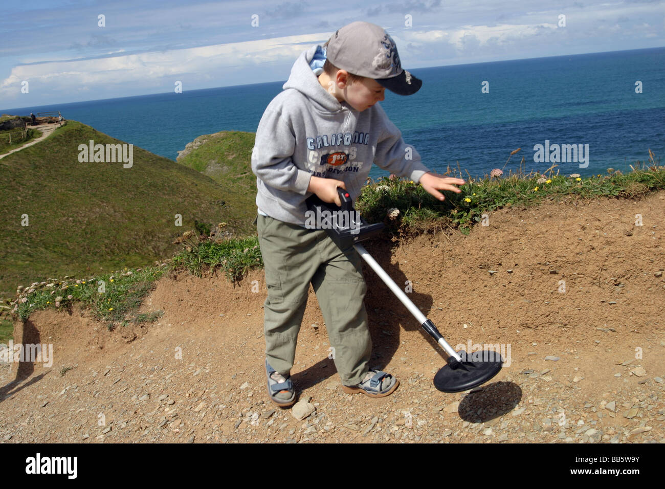 Jew Detector: Young Boy Using A Metal Detector, Cornwall Stock Photo