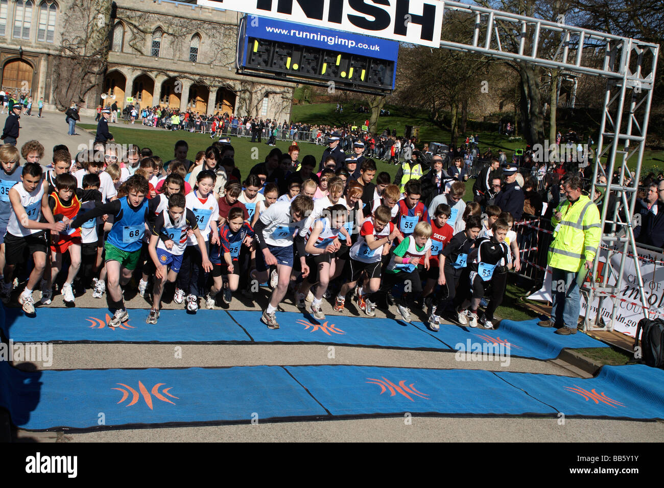 Start of the Secondary School Run at the Lincoln 10K Charity Run 2009.  Lincoln Castle England UK - Stock Image