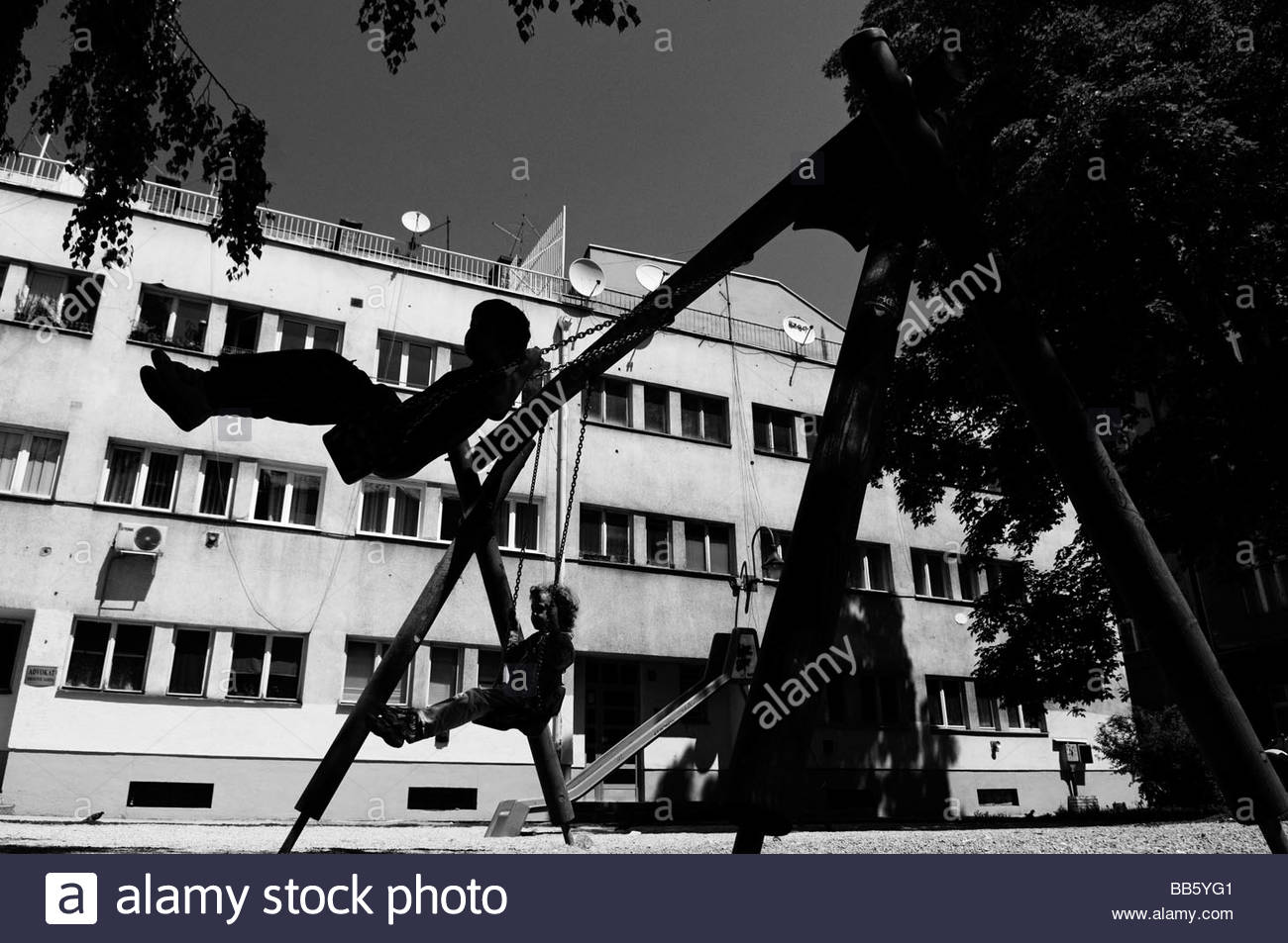 Young children playing in a playground.in the city of Sarajevo in Bosnia Herzegovina - Stock Image
