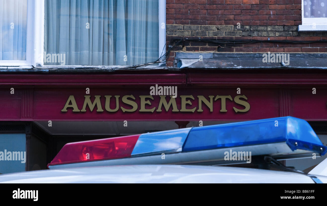 Police Car Top Lights and Amusements shop sign Stock Photo