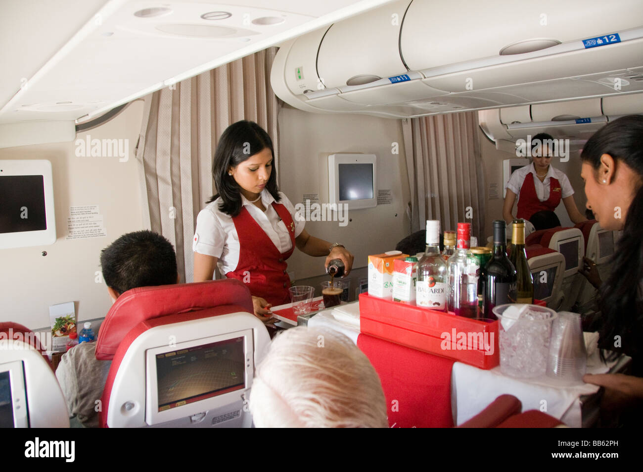 An Air Hostess Serving Drinks On Kingfisher Airlines