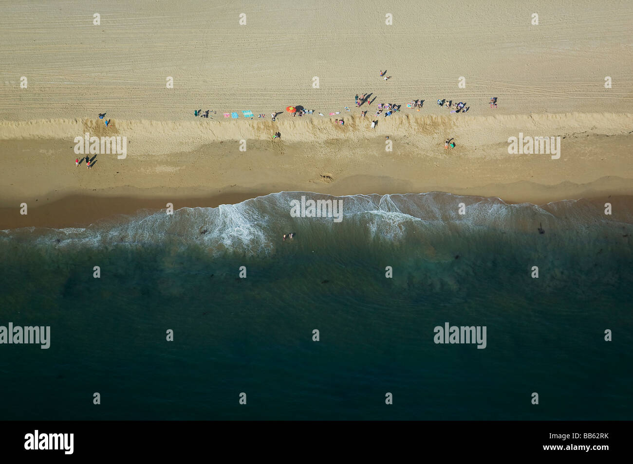 aerial view above children playing Pacific coast beach central California Stock Photo