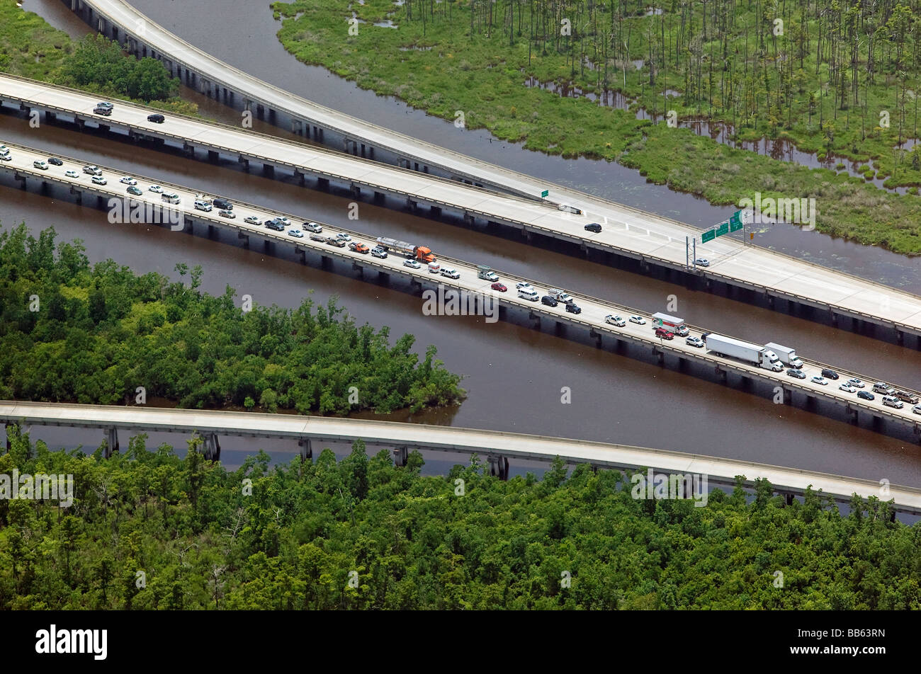 aerial view above heavy traffic leaving New Orleans Louisana metropolitan area on Interstate 10 crossing wetlands - Stock Image