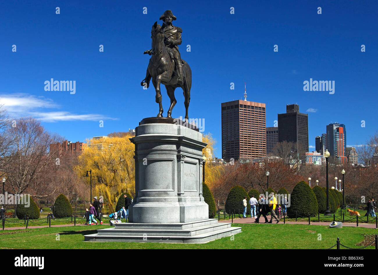 Equestrian statue of George Washington in the Boston Public Garden with the skyline of the financial district of - Stock Image