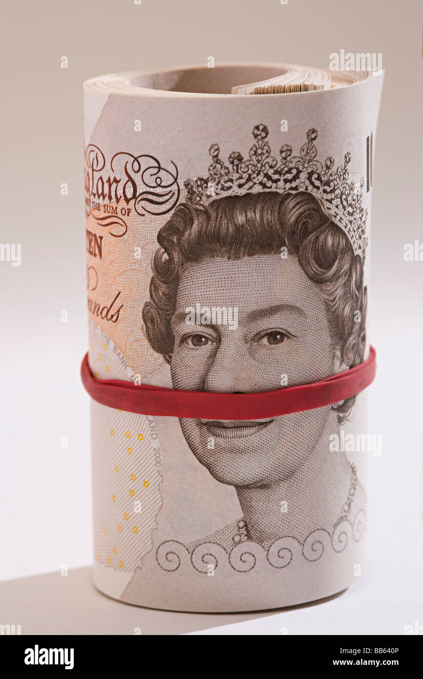 new and unused roll of UK Sterling mint ten pound bank notes rolled up. - Stock Image
