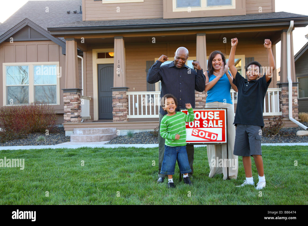 African American family celebrates new home purchase - Stock Image