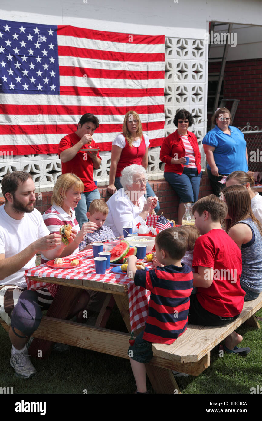 Large family gathering for a 4th of July barbecue - Stock Image