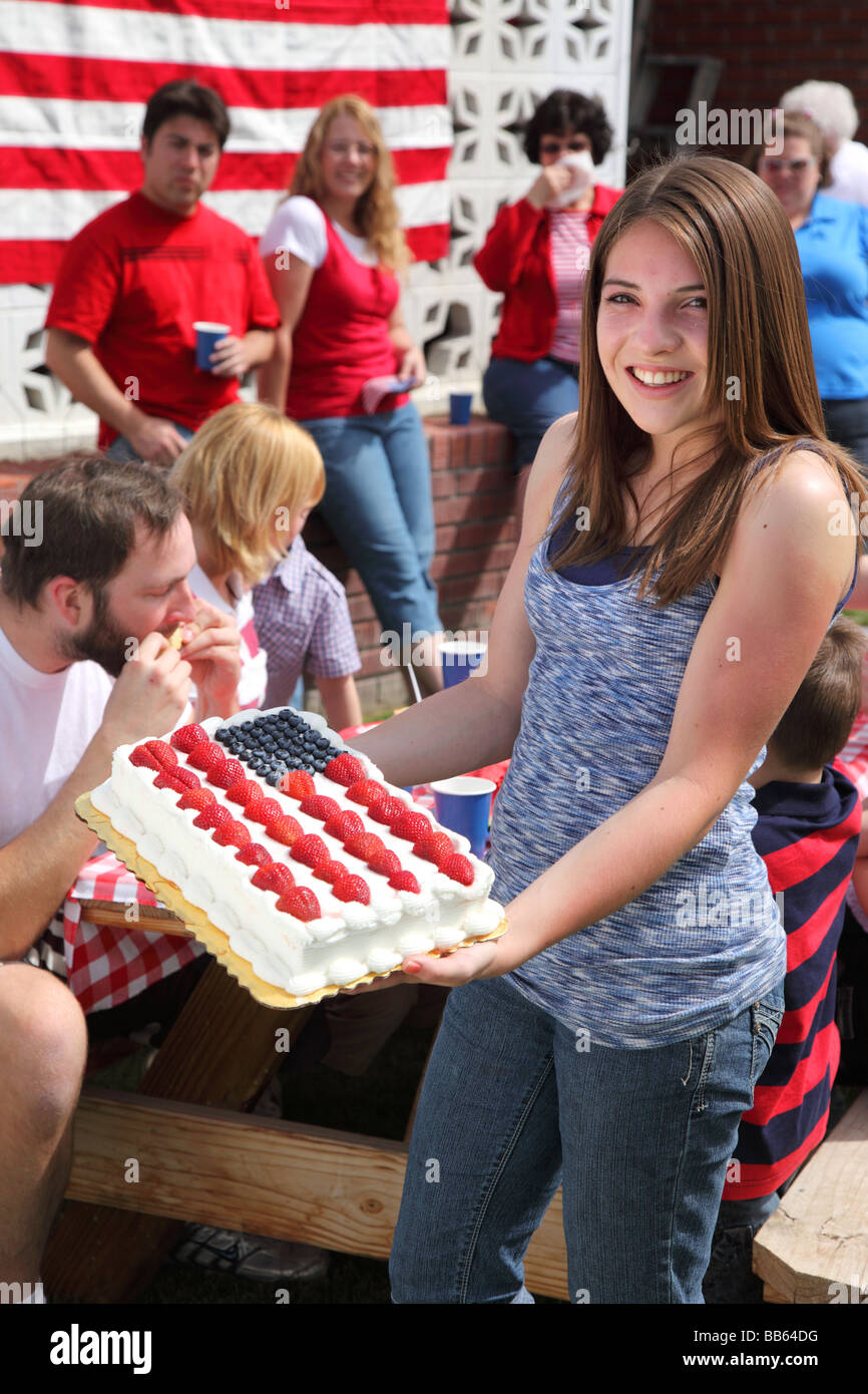 Girl holding a Patriotic cake - Stock Image