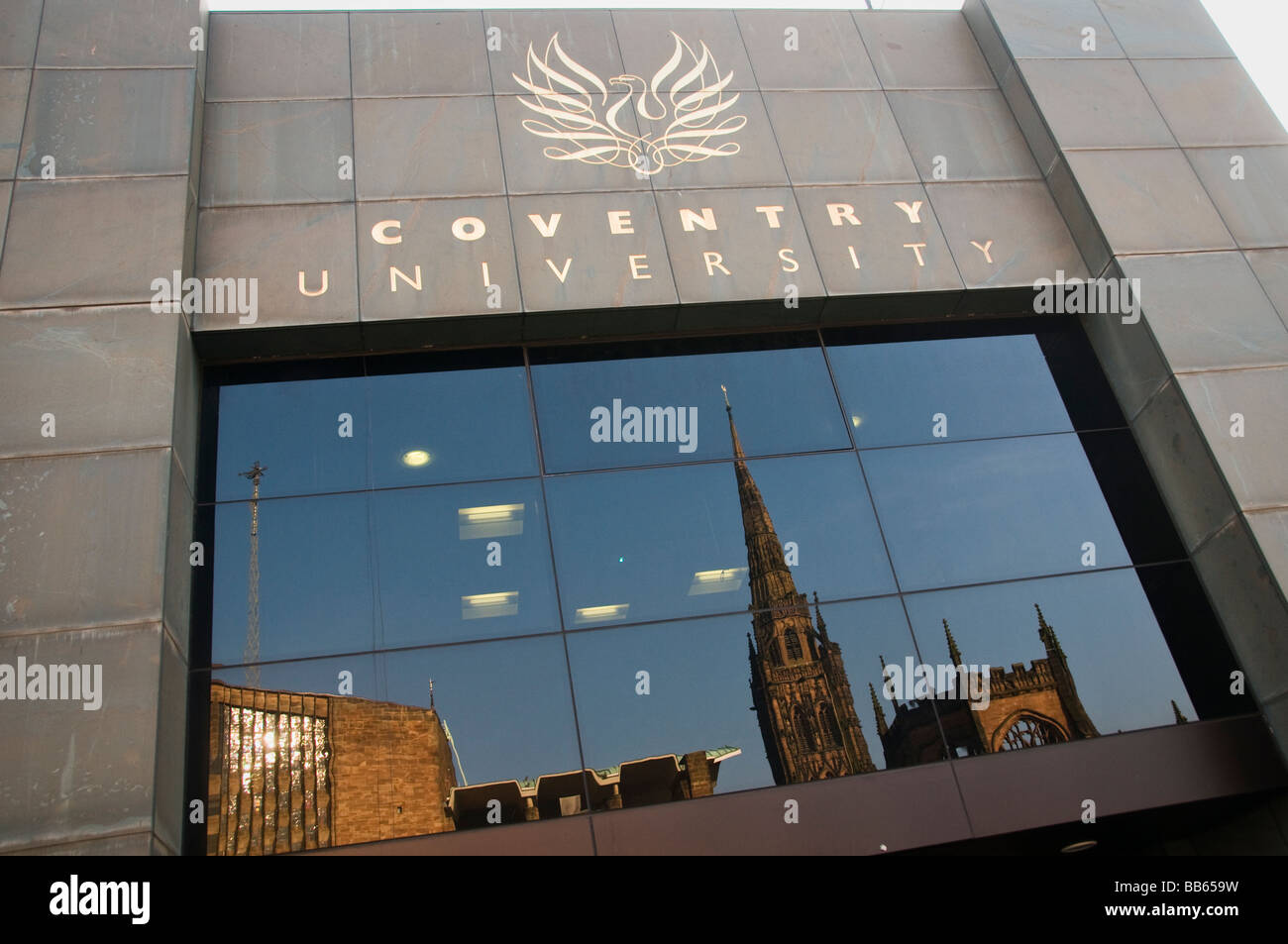 Entrance to Coventry University in Britain with the cathedral reflected in the entrance - Stock Image