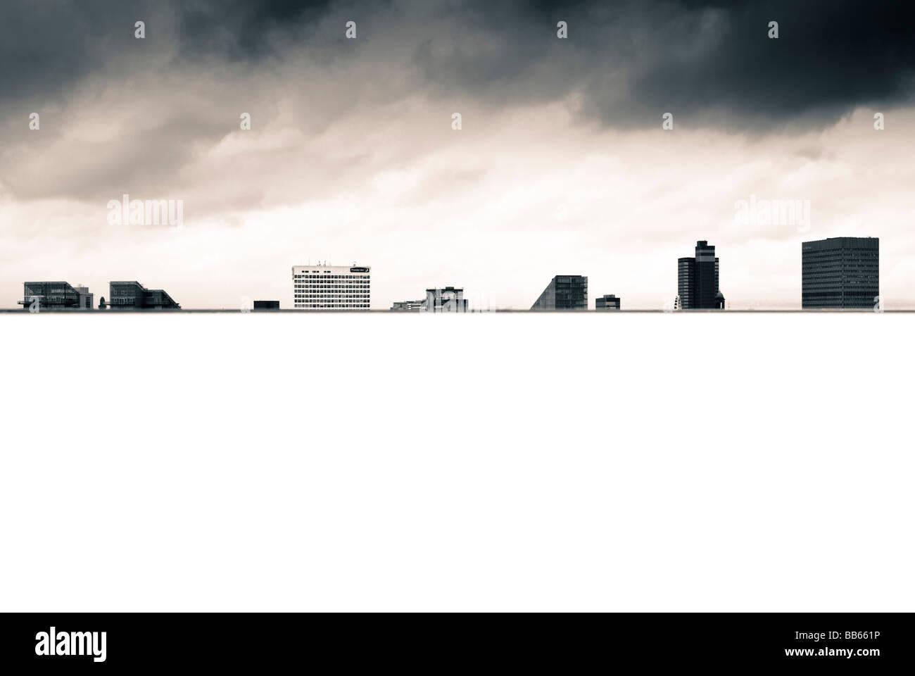 Skyline of Manchester City Centre, UK, with a stormy sky - Stock Image