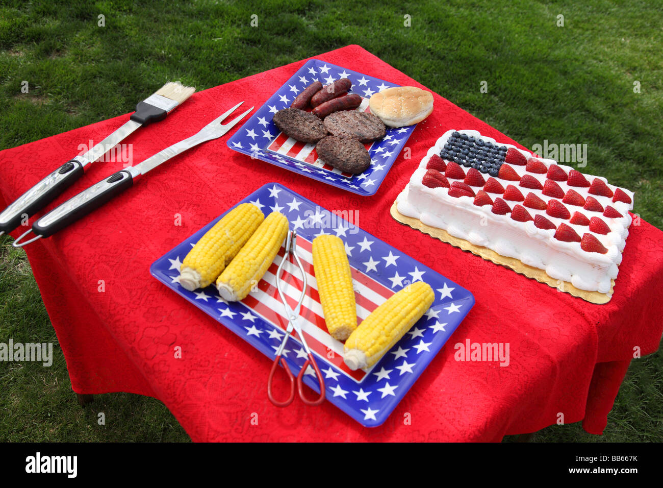 Table of food prepared for 4th of July barbecue - Stock Image