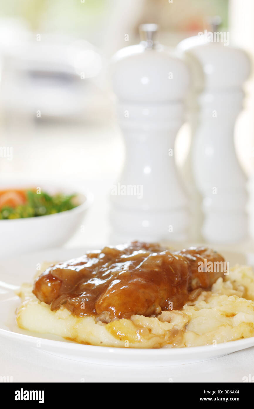 Fresh Pork Sausages With Mash Potatoes Served On A White Plate With No People Stock Photo