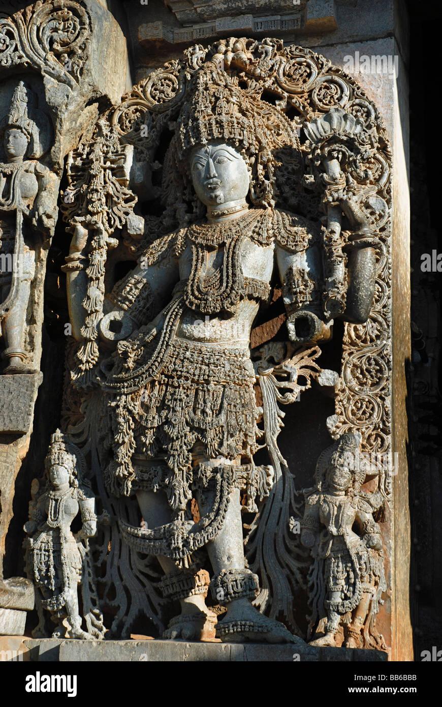 Halibid - Karnataka - Highly ornamented Vishnu on the Western wall of the temple. - Stock Image