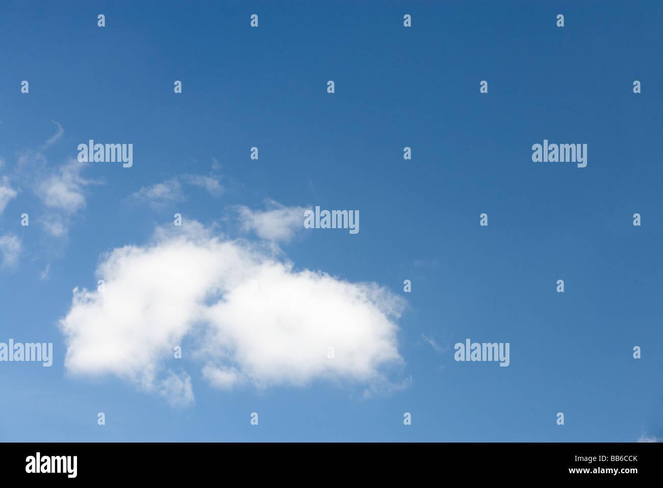 White Fluffy Cloud Against Blue Sky - Stock Image