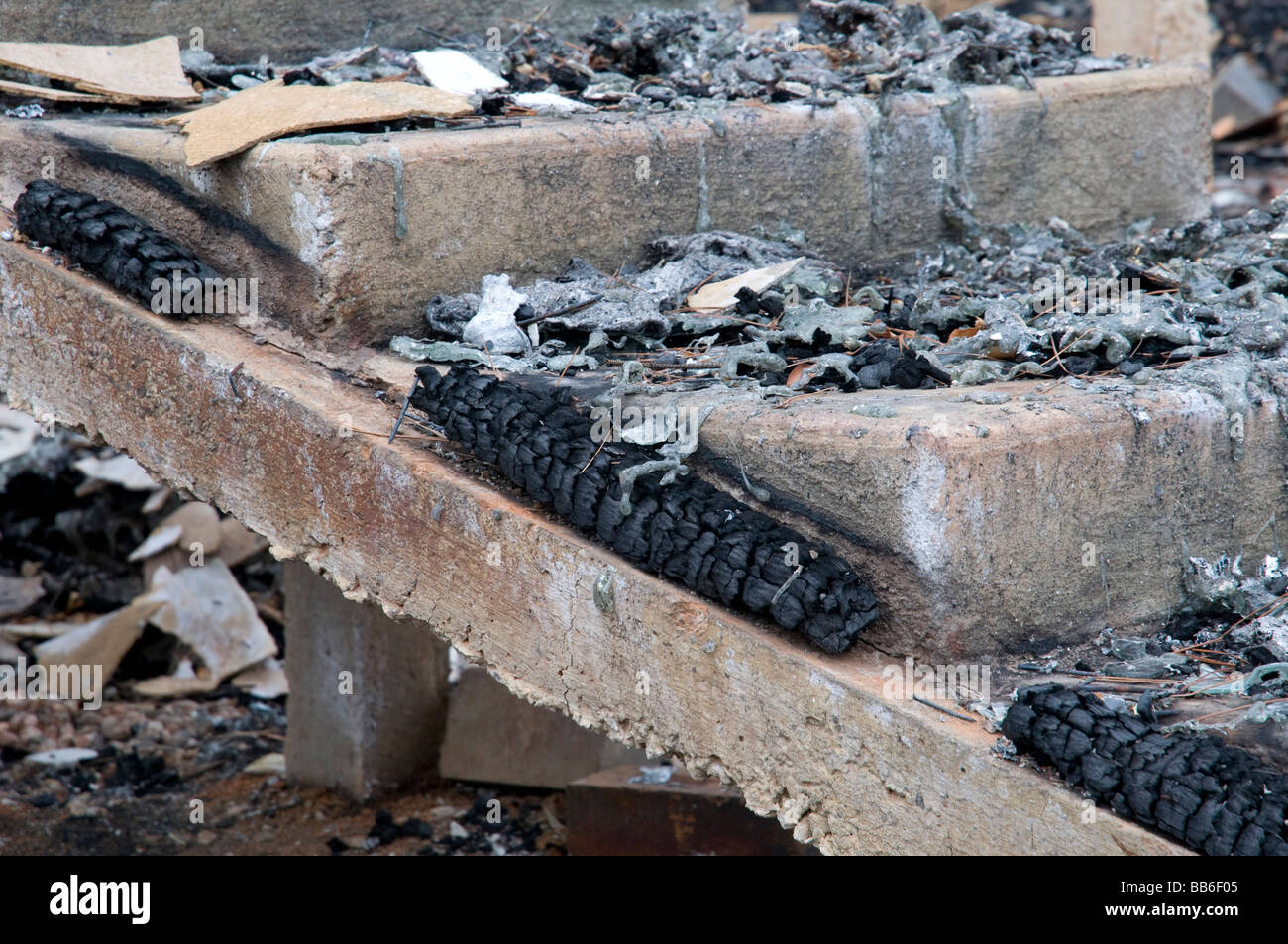 The remains of a home and devastation left after a bushfire - Stock Image