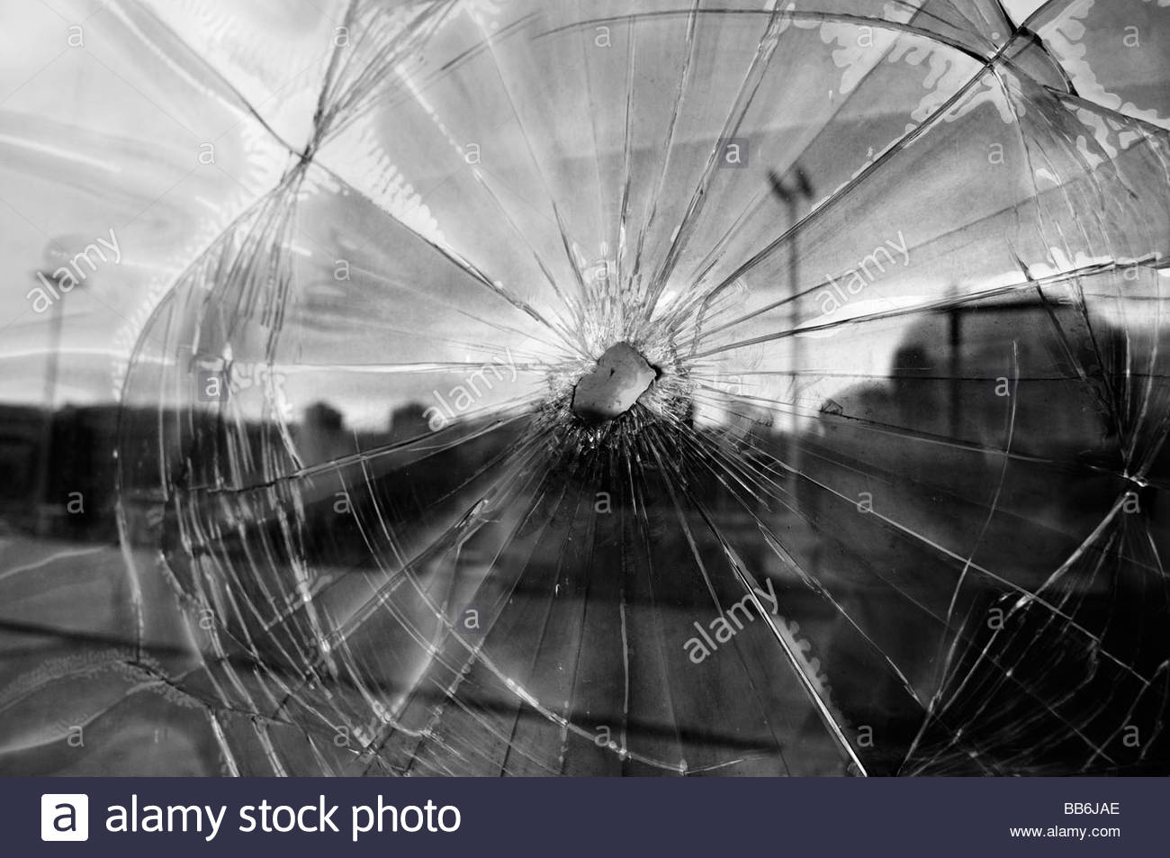 Exterior window shows shrapnel damage from the 1992-95 war in the town of Tuzla in Bosnia Herzegovina - Stock Image