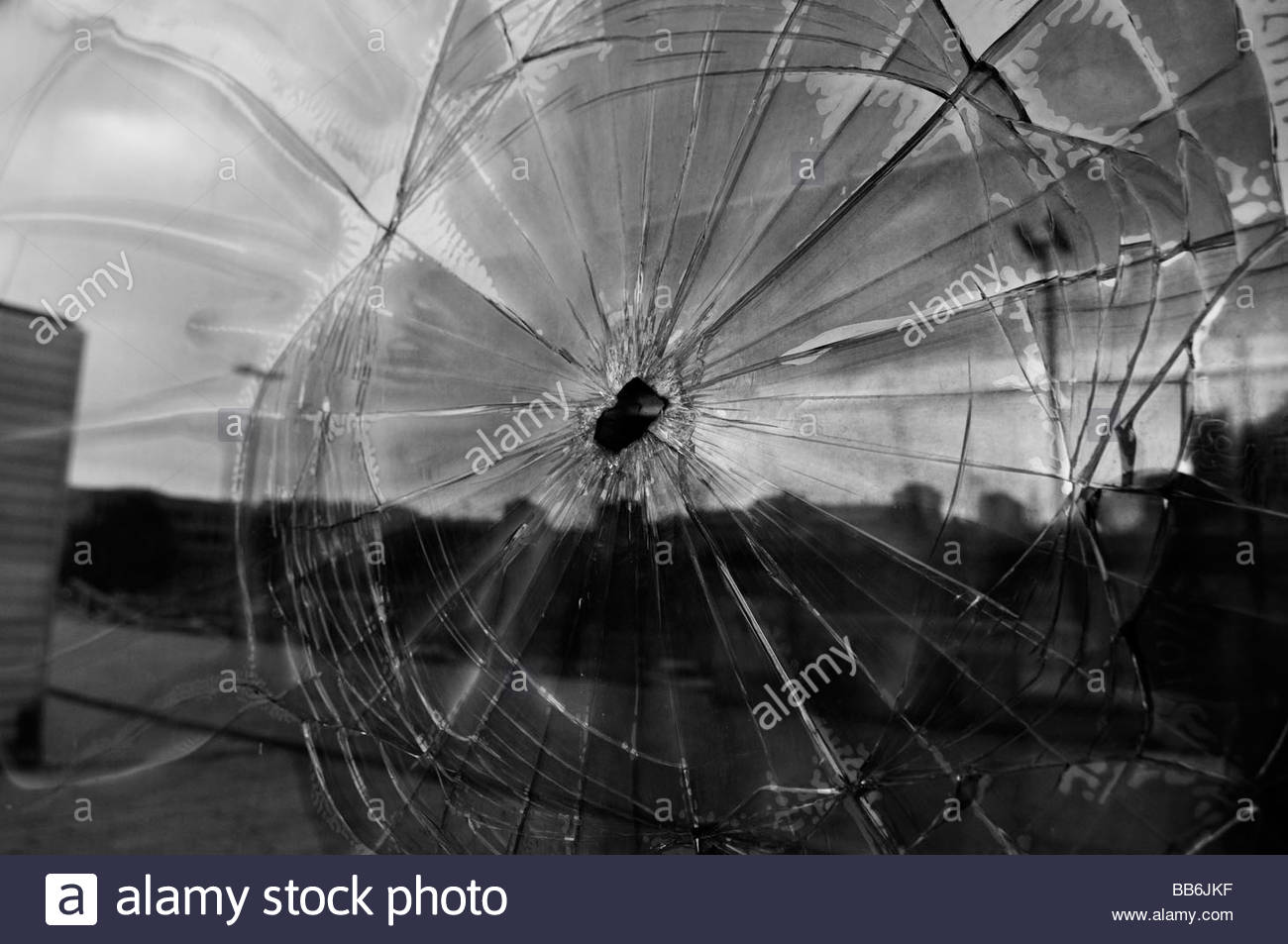 Exterior window  shows shrapnel damage from the 1992-95 war in town of Tuzla.  Bosnia Herzegovina - Stock Image