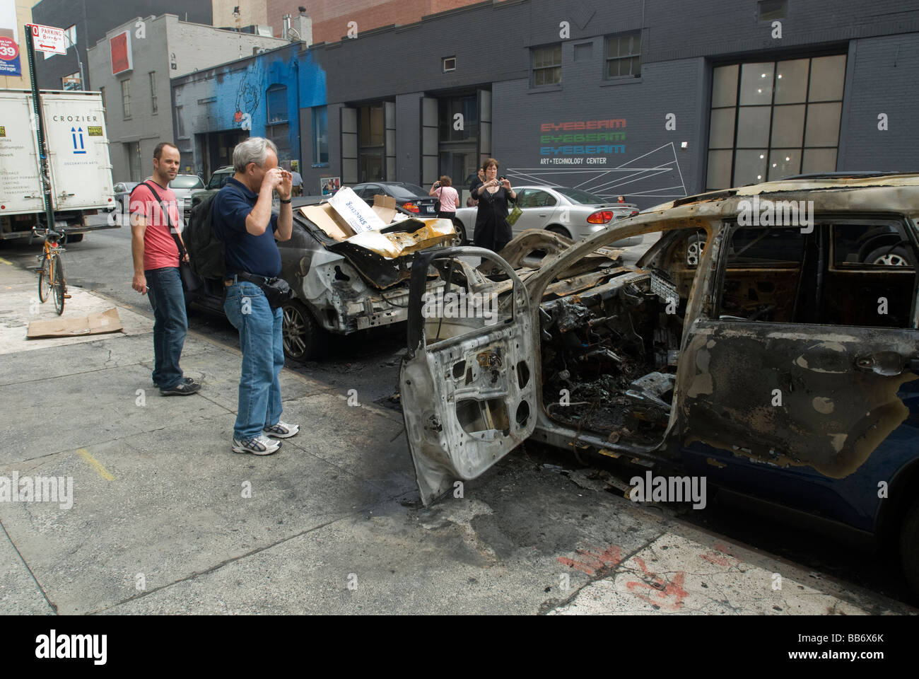 Automobiles burnt after an accident are seen on a street in the trendy West Chelsea gallery district in New York - Stock Image