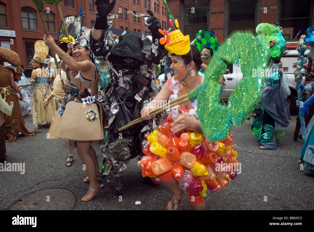 Recyclers battle trash in a piece of street theater during the Earth Celebrations Hudson River Pageant in New York - Stock Image