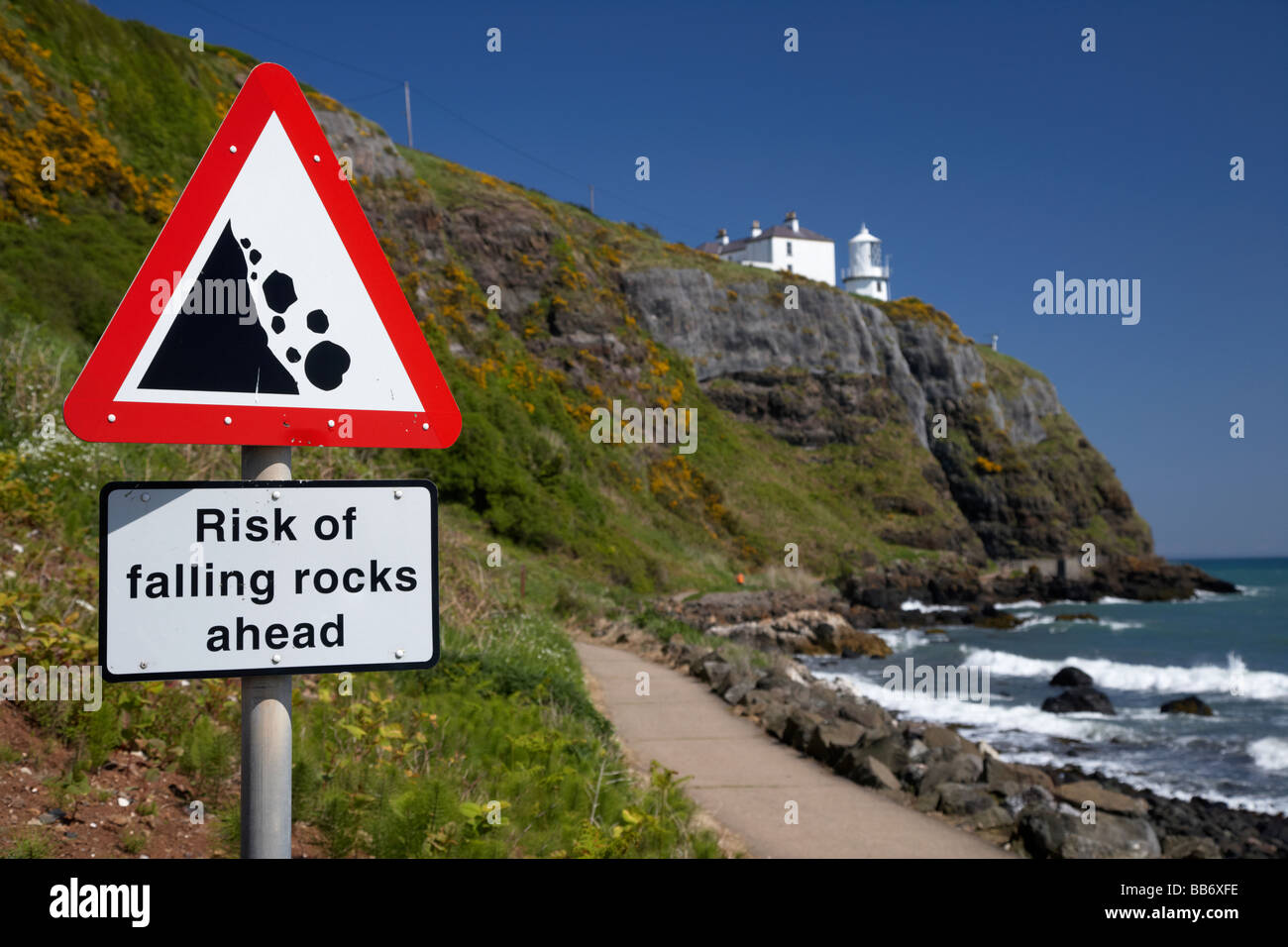 risk of falling rocks sign at blackhead lighthouse and the whitehead to blackhead coastal path county antrim northern - Stock Image