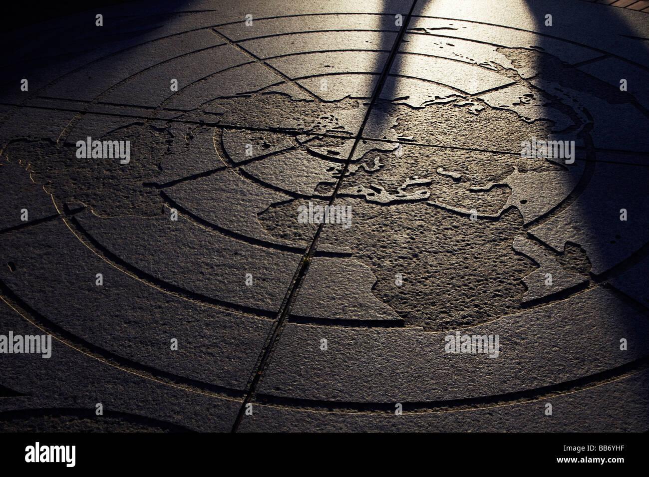 world map engraved on concrete sidewalk - Stock Image