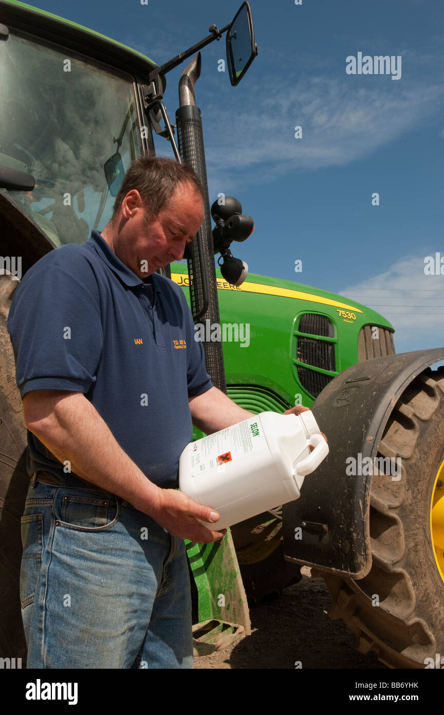 Farmer reading instructions on the back of a packet of crop spray Hartlepool - Stock Image
