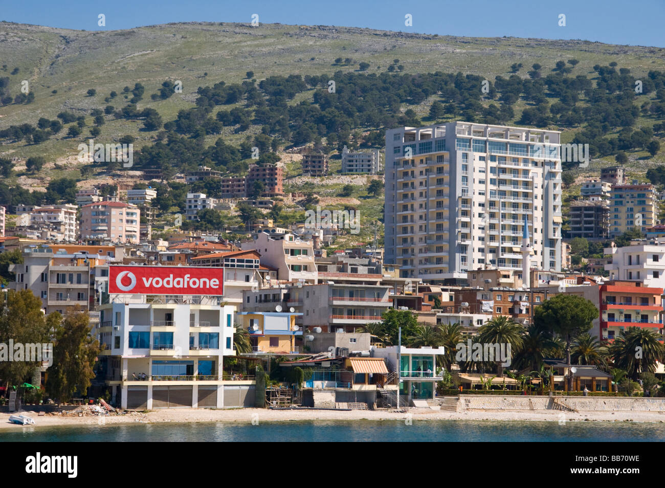 First thing you notice approaching the city of Saranda Republic of Albania by ferry is the enormous rooftop vodafone - Stock Image