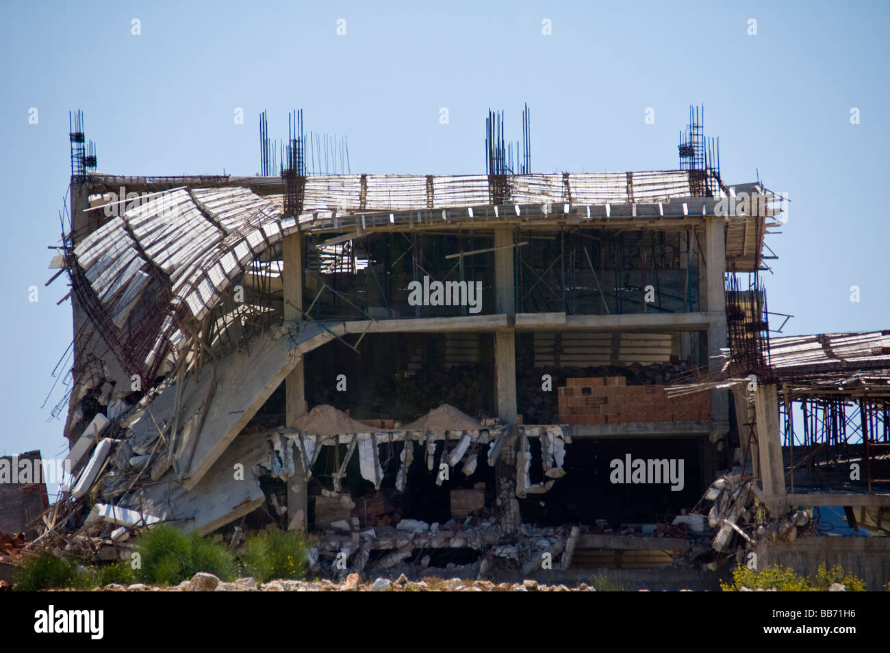 Illegally constructed apartment building partially demolished in city of Saranda Republic of Albania - Stock Image