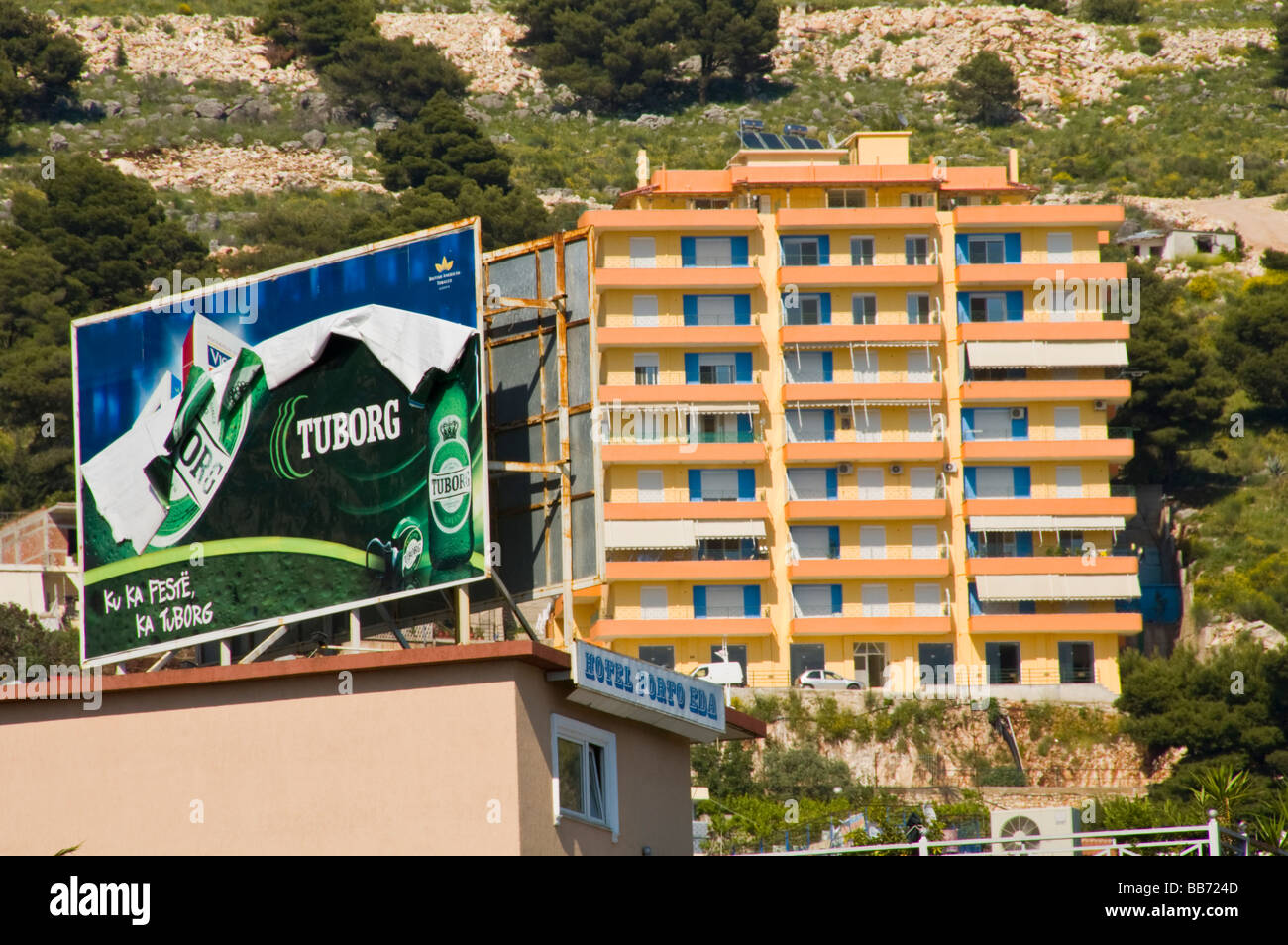 Advertising billboard for Tuborg lager on rooftop in Saranda Republic of Albania with holiday apartment sbehind - Stock Image