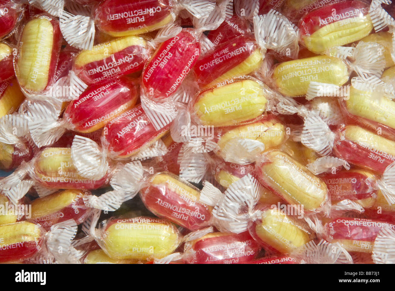Close up shot of hard boiled sweets in wrappers - Stock Image