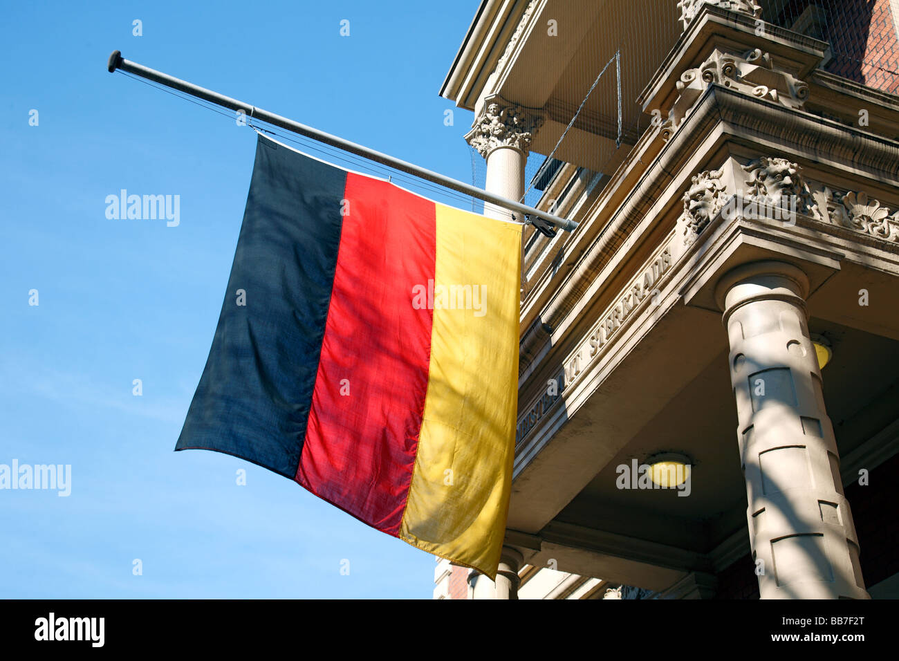 symbolism, emotions, mourning, remembrance, flag at half-mast, German flag at the Sterkrade town hall, hoisting - Stock Image