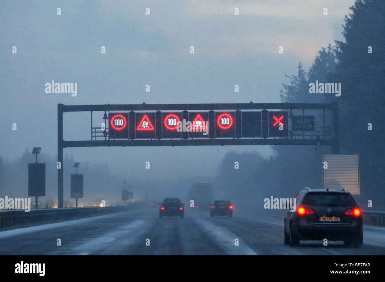 Busy motorway in driving snow, Bavaria, Germany, Europe Stock Photo