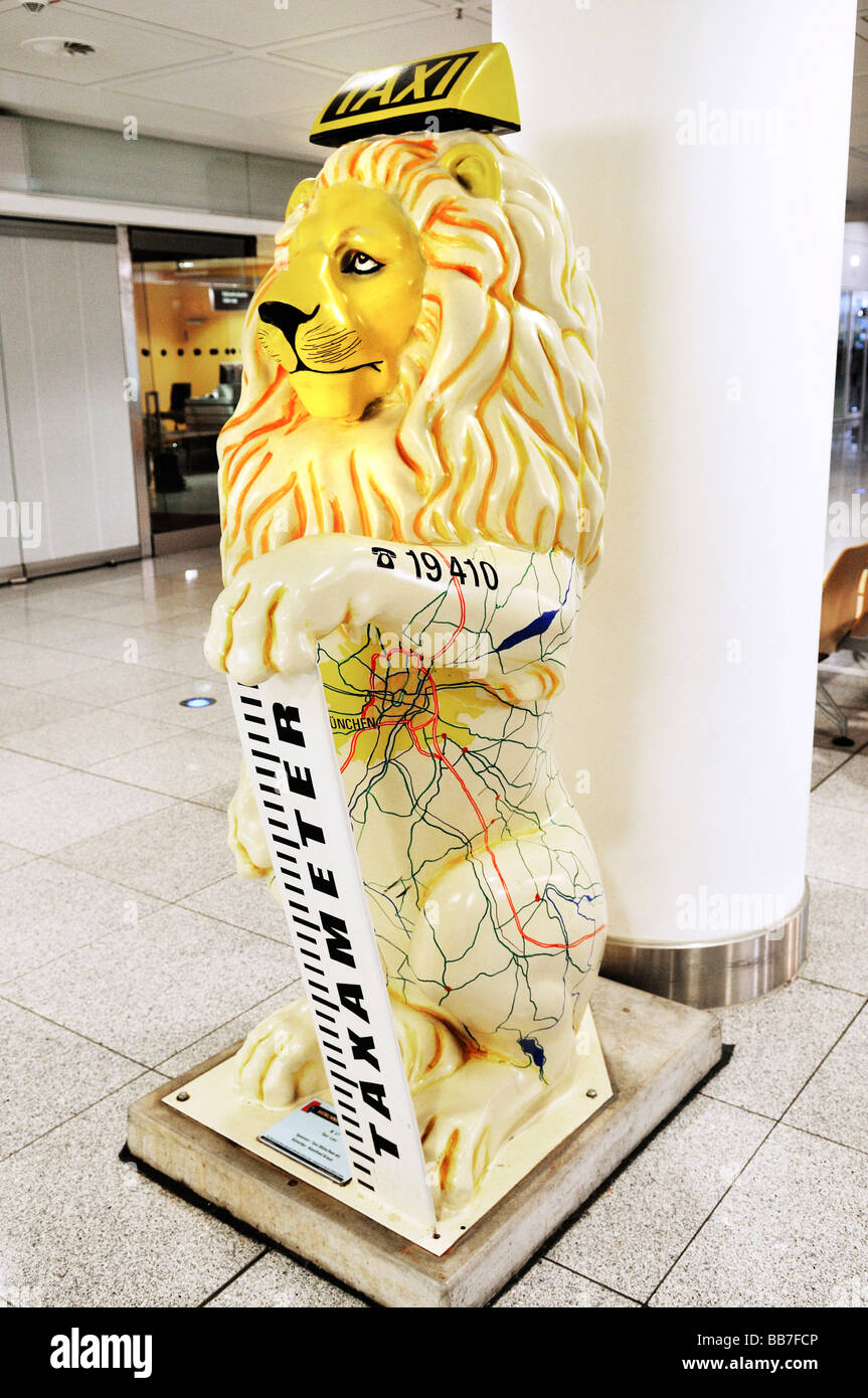 'Taxi lion' with phonenumber, Loewenparade, MUC II Airport, Munich, Bavaria, Germany, Europe - Stock Image
