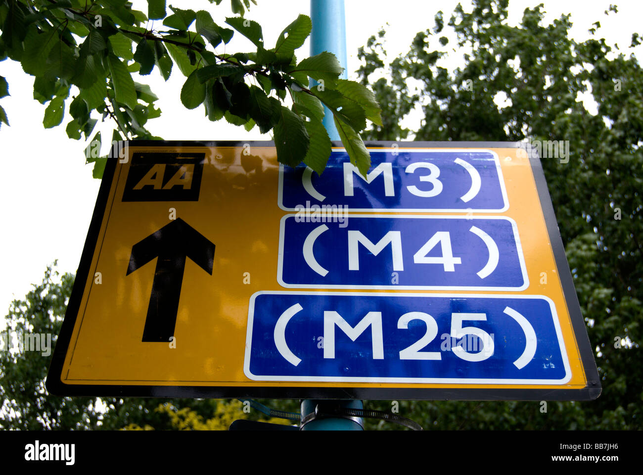 british aa road sign showing directions to motorways m3, m4 and m25, adjacent to twickenham stadium, middlesex, - Stock Image