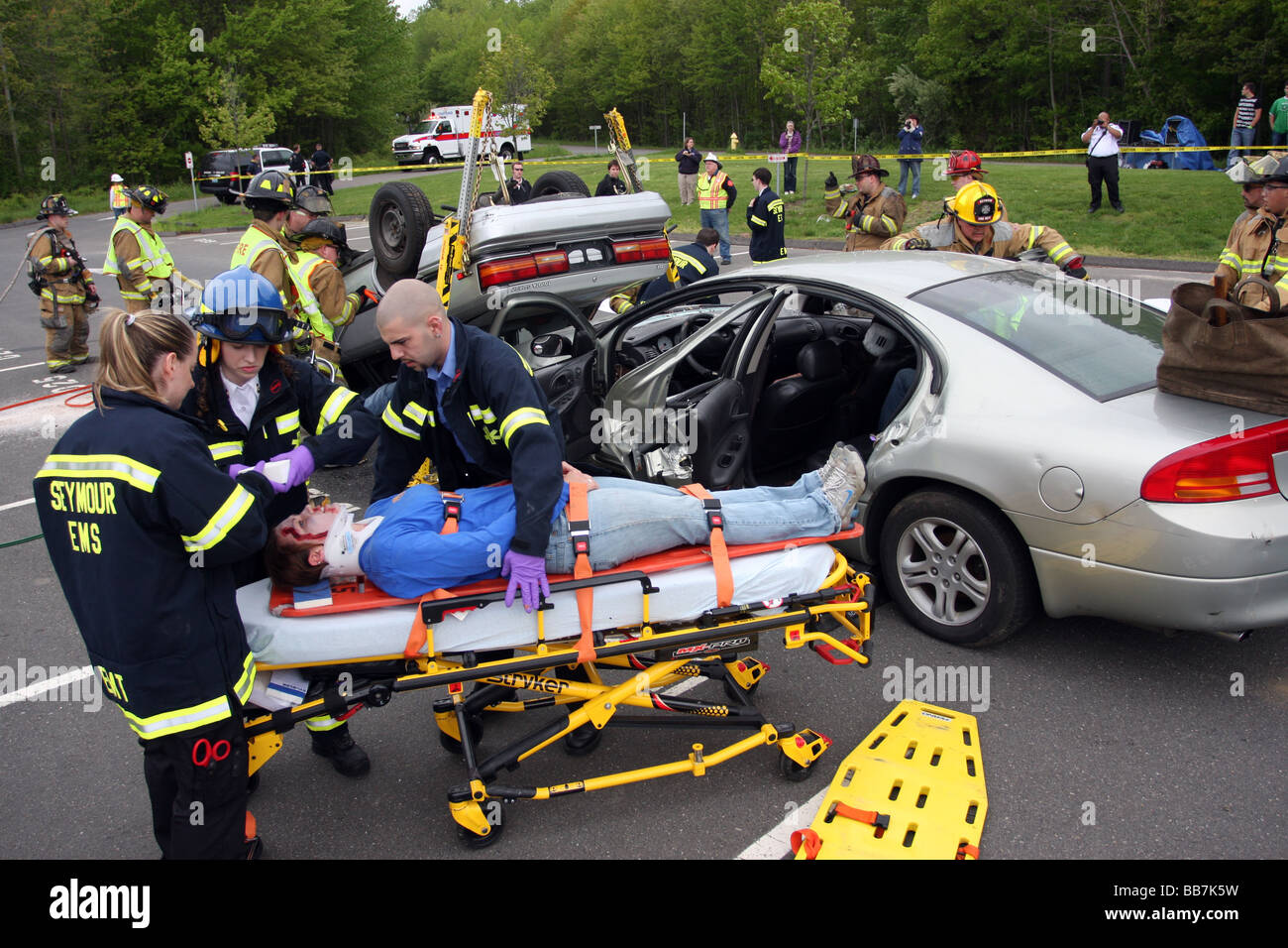 Emergency workers extract students in a mock DUI Crash in Seymour Connecticut USA - Stock Image