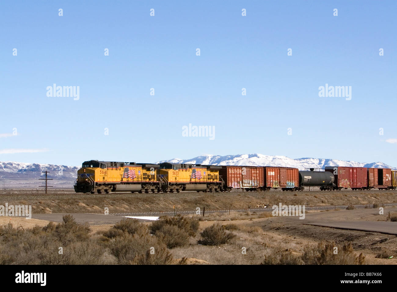 Freight train east of Boise Idaho - Stock Image