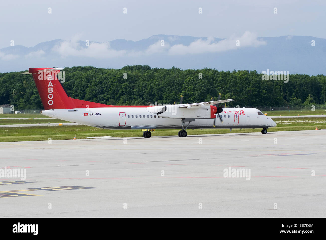 Baboo Airlines Bombardier DHC-8-402 Q400 HB-JQA Airliner Taxiing at Geneva Airport Switzerland Geneve Suisse Stock Photo