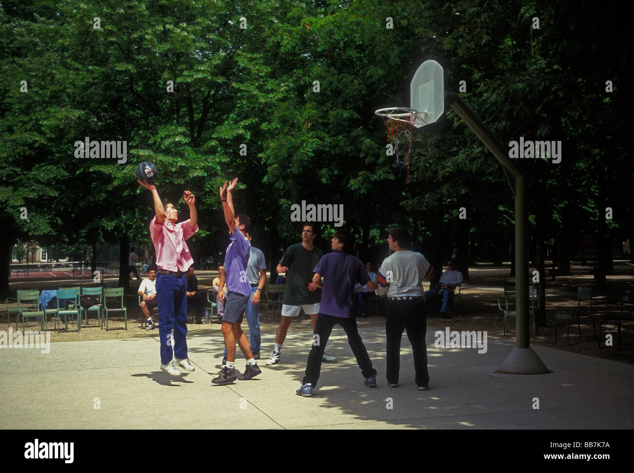 French men playing basketball, French men, basketball players, playing basketball, Luxembourg Gardens, Paris, Ile - Stock Image