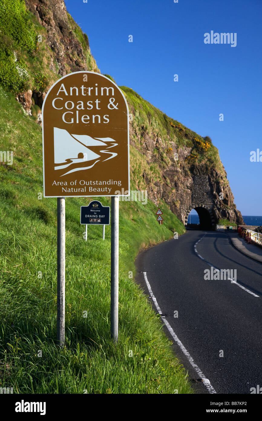 Antrim coast and glens sign on the A2 causeway coastal route coast road passes through the black arch outside Larne Stock Photo