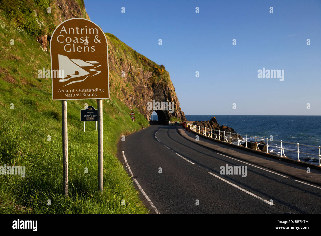 Antrim coast and glens sign on the A2 causeway coastal route coast road passes through the black arch outside Larne - Stock Image