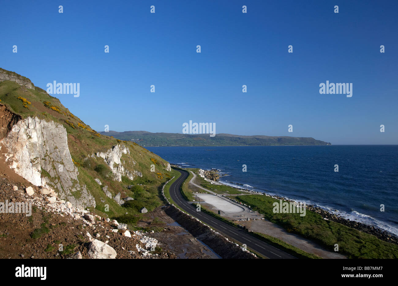 twisty section of the A2 causeway coastal route coast road County Antrim Northern Ireland UK - Stock Image