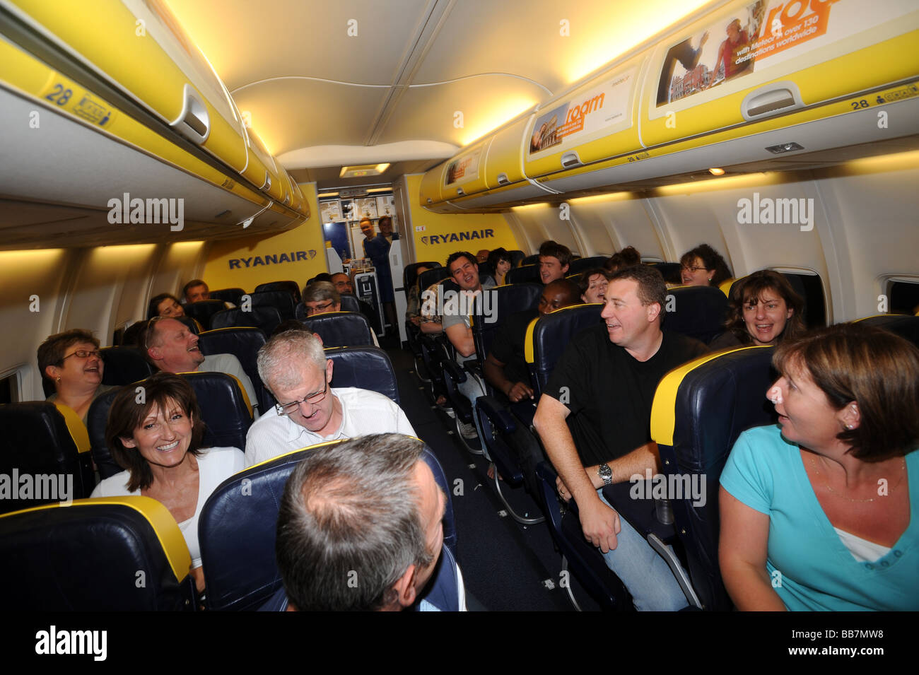 Airline passengers traveling on budget Jet - Stock Image